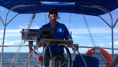 Owner, Bill at the helm of his boat.